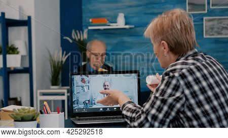Retired Woman Talking At Telehealth Session By Internet With Young Doctor, Virtual Consulting, Telem