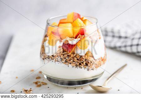 Greek Yogurt Parfait With Granola And Peach