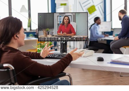 Handicapped Invalid Immobilized Business Woman Talking About Sale Report In Video Conference Working