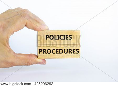 Policies And Procedures Symbol. Wooden Blocks With Concept Words Policies Procedures On White Backgr