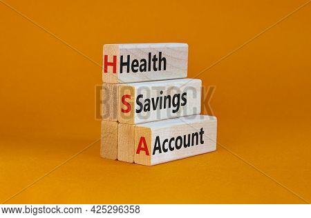 Hsa Health Savings Account Symbol. Concept Words Hsa Health Savings Account On Wooden Blocks On A Be