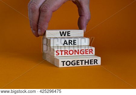 Stronger Together Symbol. Wooden Block With Words 'we Are Stronger Together'. Beautiful Orange Backg