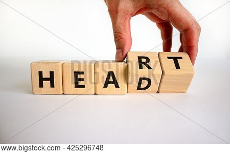 Heart Or Head Symbol. Doctor Turns Wooden Cubes And Changes The Word 'head' To 'heart'. Beautiful Wh