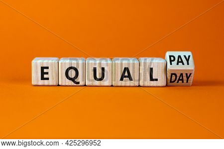 Equal Pay Day Symbol. Turned The Wooden Cube And Changed Words Equal Pay To Equal Day. Beautiful Ora