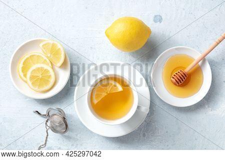 Lemon Tea With Honey, A Flat Lay, Top Shot. Organic Lemons. Healthy And Tasty Citrus Detox Drink