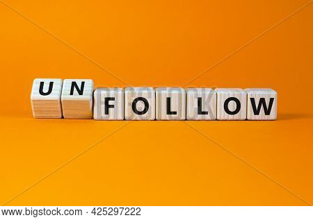 Follow Or Unfollow Symbol. Turned Wooden Cubes And Changed Words Follow To Unfollow. Beautiful Orang