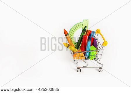 School Supplies And Office Supplies In A Trolley On A White Background. Isolated.