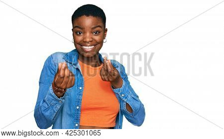 Young african american woman wearing casual clothes doing money gesture with hands, asking for salary payment, millionaire business