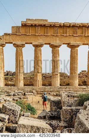 Acropolis Of Selinunte,sicily,italy.man Traveler Enjoying View Of Ruins Of Residential And Commercia