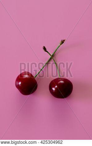 Ripe Cherries On A Pink Background. Pop Art, Vertical Orientation