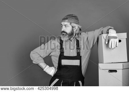 Moving Day. Bearded Man Courier Hold Boxes. Moving To New Apartment. Post Service. Bearded Loader In