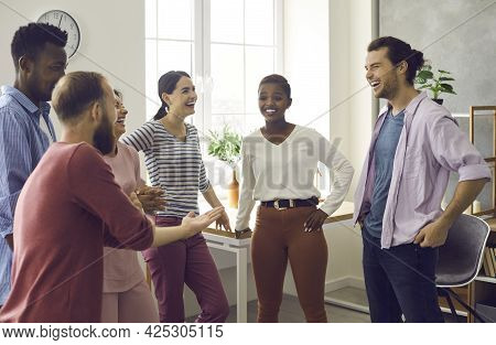 Diverse Group Of Friends Telling Funny Stories, Laughing And Having Fun Together