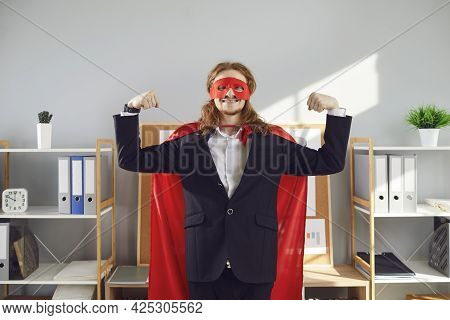 Funny Office Worker In Red Superhero Mask And Cape Demonstrating Can-do Attitude