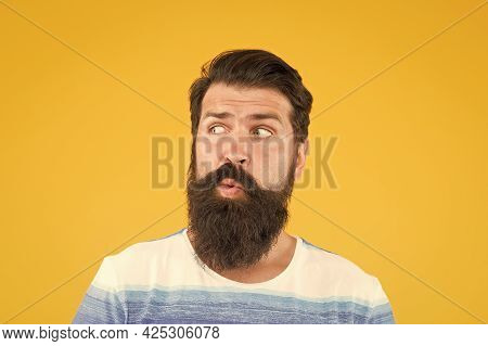 Another Idea. Have Some Doubts. Hipster Bearded Face Not Sure. Doubtful Bearded Man On Yellow Backgr