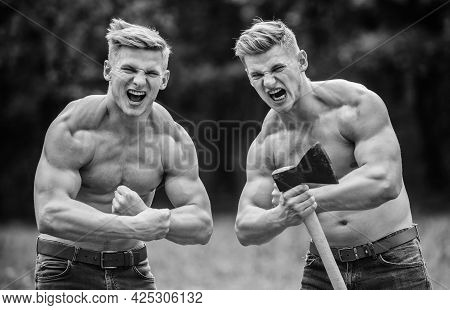 Double Force Power. Masculinity And Brutality Concept. Men With Sexy Muscular Torsos Look Brutally.