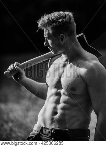 Always In Shape. Illegal Logging. Woodsman With Axe In Hand. Muscular Man With Axe. Sexy Macho Bare