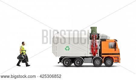 Waste collector taking bin bags towards a garbage truck isolated on white background
