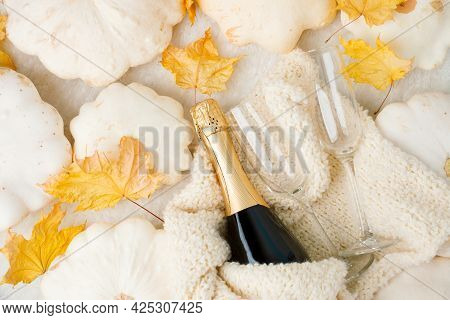 Cozy Still Life For Winter And Autumn Holiday With Wine Glasses Bottle, White Squash Pumpkin, Wollen