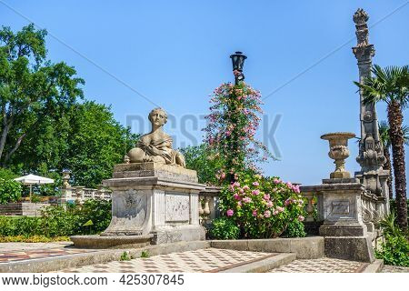 Panorama Of Old Park Decorations In Massandra Palace. There Are Sphinx With Female Head, Bowl & Colu