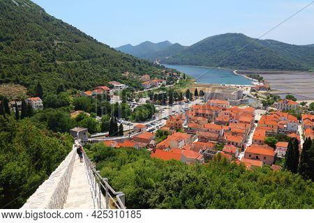 Ston, Croatia - June 20, 2021: Tourists Visit Walls Of Ston In Croatia. The Walls Are One Of The Lon