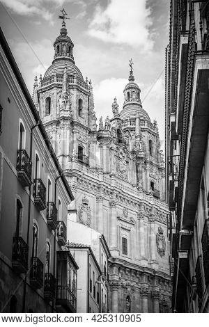 Baroque facade of La Clerecia Church in Salamanca, Spain.  Black and white photography, architecture