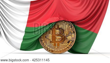 Madagascar Flag Draped Over A Bitcoin Cryptocurrency Coin. 3d Rendering