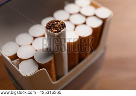 Pack Of Cigarettes On Blurred Background, Closeup
