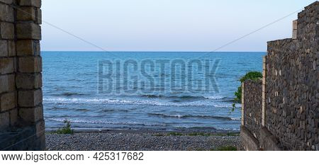 Panoramic Beautiful Seascape With Cloud On A Sunny Day. Panorama Of The Caspian Sea Summer Vacation
