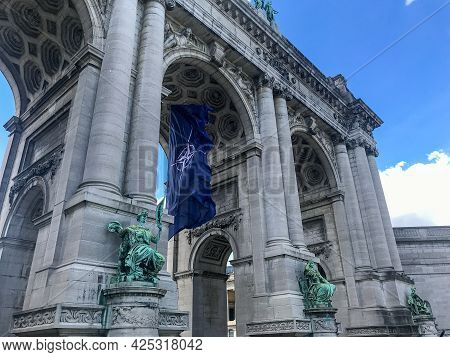 Brussels, Belgium - June 14, 2021: Nato Flag Fluttering In The Wind In The Arcades Of The Cinquanten