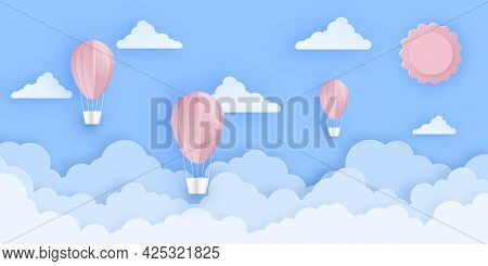 Pink Beautiful Hot Air Balloons Flying Over Fluffy Clouds In The Sky With Sun. Greeting Card, Backgr