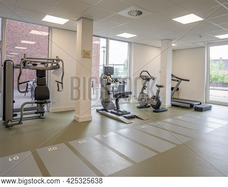 Various Fitness And Cardio Equipment In A Gym Room