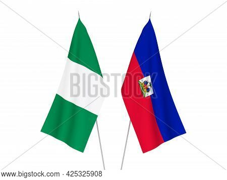 National Fabric Flags Of Nigeria And Republic Of Haiti Isolated On White Background. 3d Rendering Il