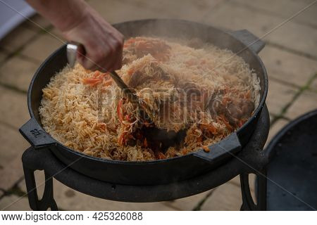 The Process Of Cooking Pilaf. National Dish Of Oriental Cuisine.