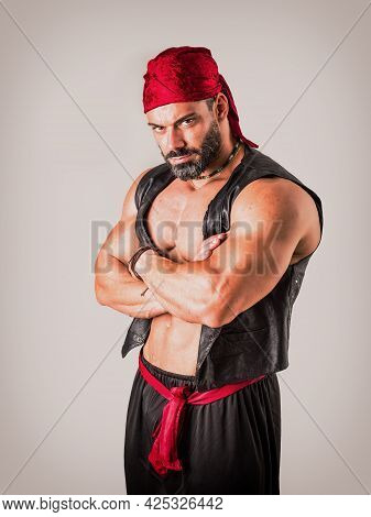 Muscular Man In Genie Costume In Studio
