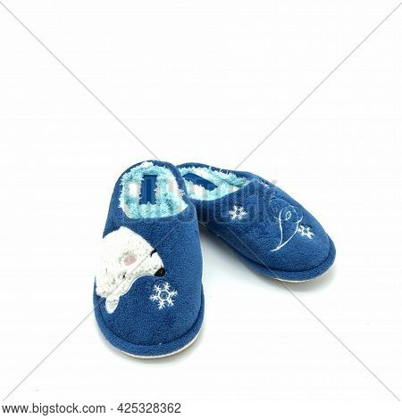 Soft Warm Women's Home Slippers. Made Of Blue Plush. Decorated With Snowflakes And A Teddy Bear's Fa