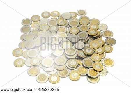 Coins Of Different Countries And Different Denominations On A White Background. European And America
