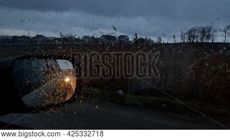 Wet Glass Texture With Raindrops On Window. Car Side View Mirror With Defocused Reflections And Blur