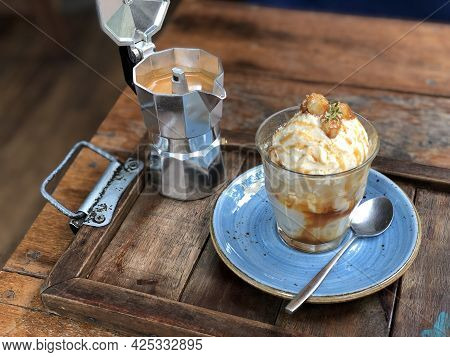 Affogato Coffee With Ice Cream In A Glasses On The Wooden Table