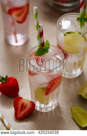 Cocktails With Fruits And Berries. Summer Cold Refreshing Fruit Drinks With Straws
