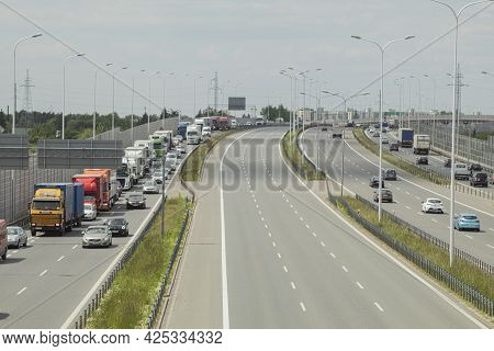Poland, Warsaw - June 02, 2021: Traffic Jam Of Cars At The Entrance To The City. Large Car Traffic F