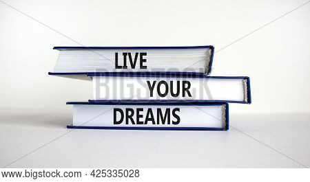 Live Your Dreams Symbol. Books With Words 'live Your Dreams'. Beautiful White Background. Business,