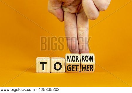 Tomorrow We Will Together Symbol. Businessman Turns Wooden Cubes And Changes The Word Together To To
