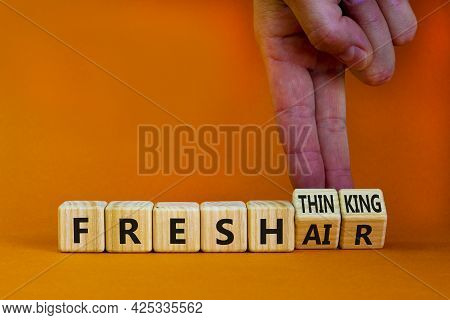 Fresh Thinking And Air Symbol. Businessman Turns Wooden Cubes, Changes Words Fresh Thinking To Fresh