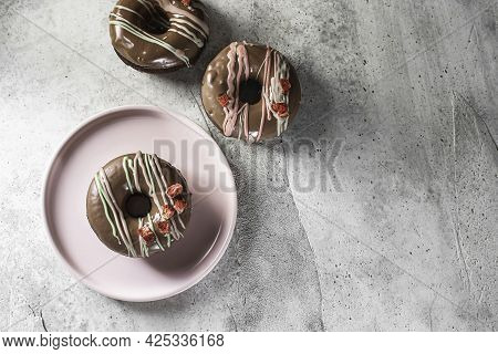 Homemade Chocolate Donuts With Chocolate Coating. National Donut Day. Homemade Baking.