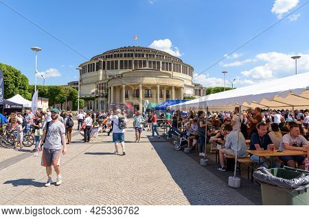 Worclaw, Poland - June 6, 2021: People Eat In Food Truck Zone In Front Of The Centennial Hall