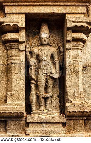 Hindu god Vishnu stone bas relief in Hindu temple, Arunachaleswar Temple, Tiruvannamalai, Tamil Nadu, India