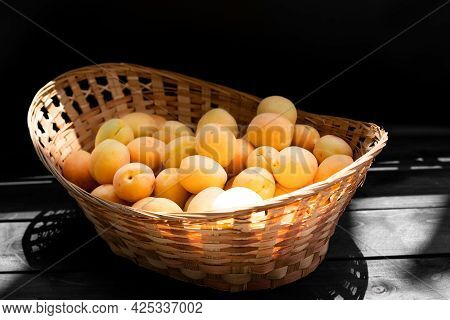 Ripe Apricots On A Wooden Background.ripe Apricots On A Wooden Background