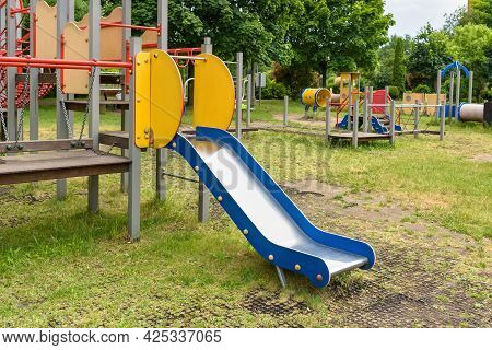 Empty Slide On The Playground In The Park