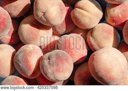 Ripe Peaches As Background In Sunbeams.ripe Peaches As Background In Sunbeams