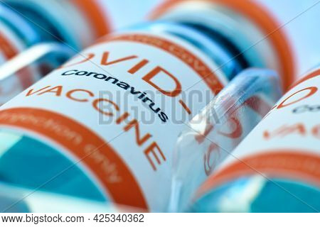 Bottles With Sars-cov-2 Vaccine. Medicine And Coronavirus Pandemic Concept. Close Up